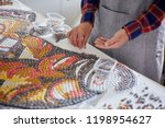 faceless shot of man arranging... | Shutterstock . vector #1198954627