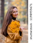 pretty young woman walking in... | Shutterstock . vector #1198955671