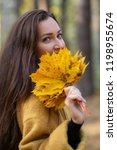 pretty young woman walking in... | Shutterstock . vector #1198955674