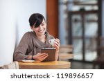 young happy woman sitting in... | Shutterstock . vector #119896657