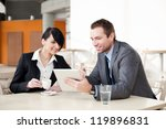 Business meeting with digital tablet in coffee shop - stock photo