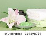 beautiful spa setting on green background - stock photo