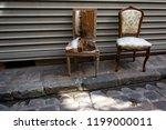 torn broken armchair and... | Shutterstock . vector #1199000011