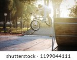 bmx biker jumps with bicycle... | Shutterstock . vector #1199044111