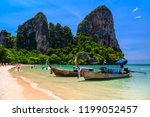 long tail boats and rocks on... | Shutterstock . vector #1199052457