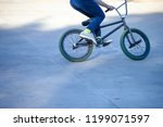 young guy with a sports bike is ... | Shutterstock . vector #1199071597