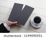 mens hand holding empty black...   Shutterstock . vector #1199090551