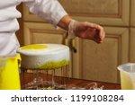 cook preparing mousse cake... | Shutterstock . vector #1199108284