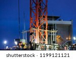 tower crane lift cement bucket... | Shutterstock . vector #1199121121