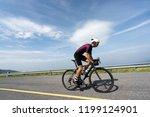 asian man cycling road bike in... | Shutterstock . vector #1199124901
