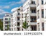 The facade of some white modern apartment buidlings seen in Berlin, Germany