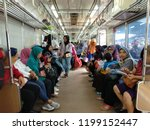 Small photo of Jakarta, Indonesia - November 20, 2017: View inside the female-only train car of Jakarta Commuter Line at Tanah Abang Station.