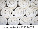 rolled up white spa towels   Shutterstock . vector #119916391