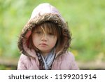 sad shaggy toddler in a jacket... | Shutterstock . vector #1199201914