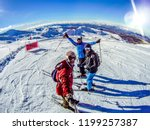 Grandvalira / Andorra - January 1 - 2015: Skiers friends group taking fish eye selfie with gopro stick at snowy mountain top covered in snow skiing in Spain. Ski Winter sports with friend, holidays - stock photo