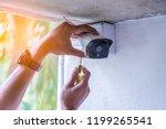 technician installing ip... | Shutterstock . vector #1199265541
