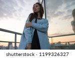 attractive young woman stands... | Shutterstock . vector #1199326327