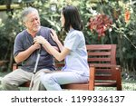 nurse with patient sitting on...   Shutterstock . vector #1199336137