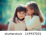 happy little girlfriends in park | Shutterstock . vector #119937031