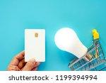 hand holding a blank white... | Shutterstock . vector #1199394994