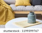 close up on grey vase on pad on ... | Shutterstock . vector #1199399767