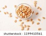 roasted untreated pumpkin seeds ... | Shutterstock . vector #1199410561