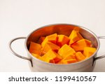 cut into pieces raw pumpkin on... | Shutterstock . vector #1199410567