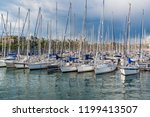 port with yachts in barcelona ... | Shutterstock . vector #1199413507