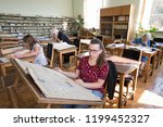 visitors read books and... | Shutterstock . vector #1199452327