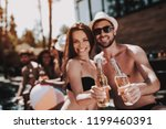 smiling couple with alcoholic... | Shutterstock . vector #1199460391