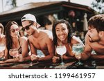 young smiling friends with... | Shutterstock . vector #1199461957