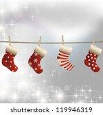 hanging christmas socks on a... | Shutterstock .eps vector #119946319