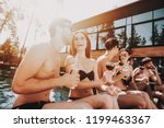 young smiling friends drinking...   Shutterstock . vector #1199463367