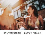 smiling couple with alcoholic... | Shutterstock . vector #1199478184