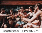young friends with alcoholic... | Shutterstock . vector #1199487274