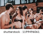 young smiling friends drinking... | Shutterstock . vector #1199496061