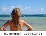 a yonge women is in front of... | Shutterstock . vector #1199513431
