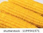 three fresh corn on white table ...   Shutterstock . vector #1199541571
