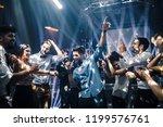 shot of a young man dancing in... | Shutterstock . vector #1199576761
