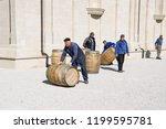 winemakers move barrels with...   Shutterstock . vector #1199595781