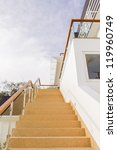 Main stair, with sand wash finishes, leading to ground floor with twilight blue sky background - stock photo