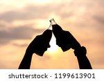 hand of man clink soft drink... | Shutterstock . vector #1199613901