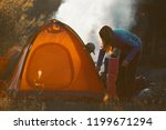hikers set the tent and make... | Shutterstock . vector #1199671294
