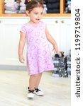 cute little girl in a shoe and... | Shutterstock . vector #1199719804