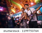 couple enjoying a game of... | Shutterstock . vector #1199753764