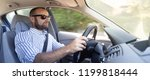 concentrated and pensive driver ... | Shutterstock . vector #1199818444