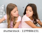 children show tongue each other.... | Shutterstock . vector #1199886151