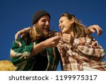laughing couple of friends... | Shutterstock . vector #1199975317
