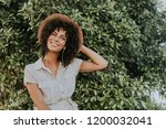 beautiful woman listening to...   Shutterstock . vector #1200032041