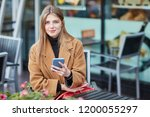 a young russian girl is typing... | Shutterstock . vector #1200055297